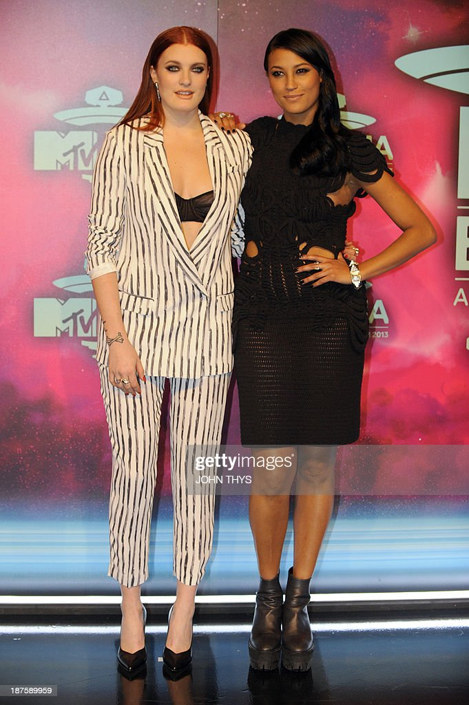 Caroline Hjelt (L) and Aino Jawo of Swedish DJ duo Icona Pop pose as they arrive to attend the MTV European Music Awards (EMA) 2013 at the Ziggo Dome on November 10, 2013 in Amsterdam, The Netherlands. AFP PHOTO / JOHN THYS