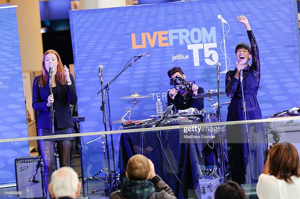 Caroline Hjelt and Aino Jawo of the band Icona Pop perform for the CMJ Music Marathon at JetBlue's 'Live From T5 Concert Series' in John F Kennedy...