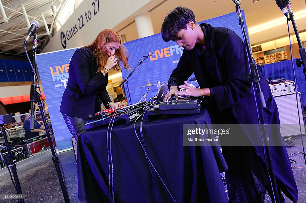 Caroline Hjelt (L) and Aino Jawo of the band Icona Pop perform for the CMJ Music Marathon at JetBlue's 'Live From T5 Concert Series' in John F. Kennedy International Airport on October 17, 2012 in New York City.