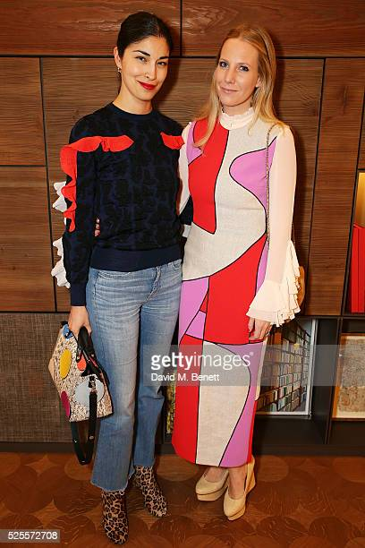 Caroline Issa and Alice NaylorLeyland attends the BFC Fashion Trust x Farfetch cocktail reception on April 28 2016 in London England