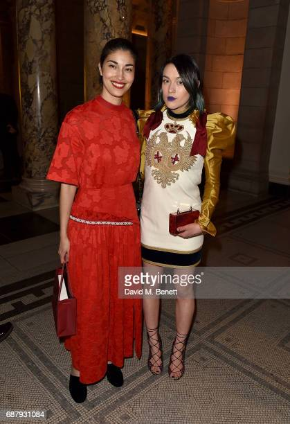 Caroline Issa and Ella Catliff attends Balenciaga Shaping Fashion VIP Preview sponsored by American Express at Victoria and Albert Museum on May 24...
