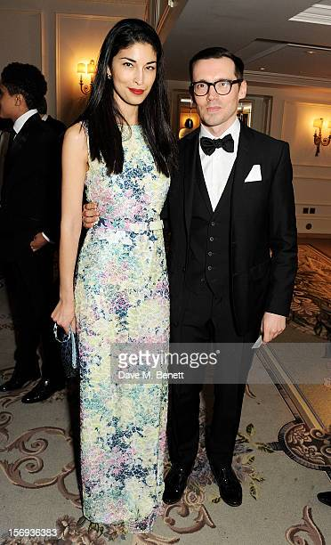 Caroline Issa and Erdem Moralioglu attend a drinks reception at the 58th London Evening Standard Theatre Awards in association with Burberry at The...
