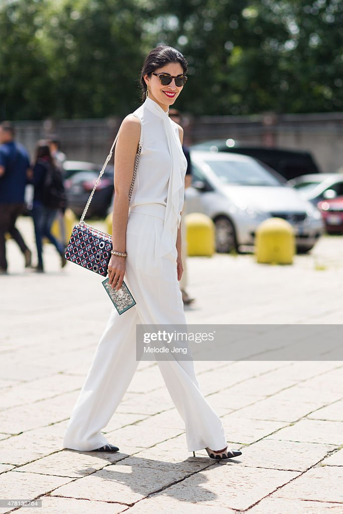 Caroline Issa enters the Gucci show on June 22 2015 in Milan Italy