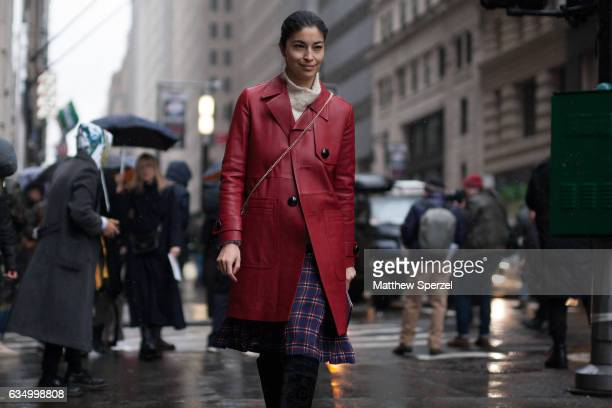 Caroline Issa is seen attending Victoria Beckham during New York Fashion Week wearing a red leather coat on February 12 2017 in New York City