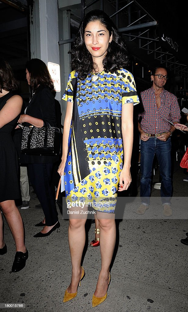 <a gi-track='captionPersonalityLinkClicked' href=/galleries/search?phrase=Caroline+Issa&family=editorial&specificpeople=2254046 ng-click='$event.stopPropagation()'>Caroline Issa</a> is seen outside the Altuzarra show on September 7, 2013 in New York City.