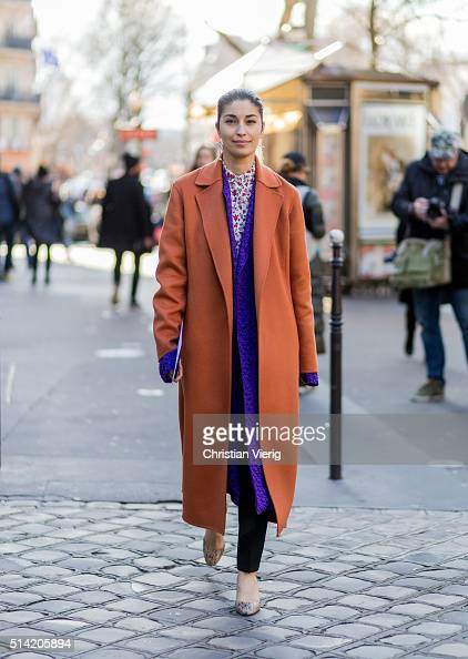 Caroline Issa is wearing an orange coat and a purple coat underneath outside Hermes during the Paris Fashion Week Womenswear Fall/Winter 2016/2017 on...