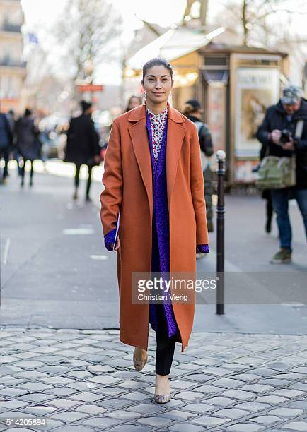 Caroline Issa is wearing an orange coat and a purple coat underneath outside Hermes during the Paris Fashion Week Womenswear Fall/Winter 2016/2017 on...