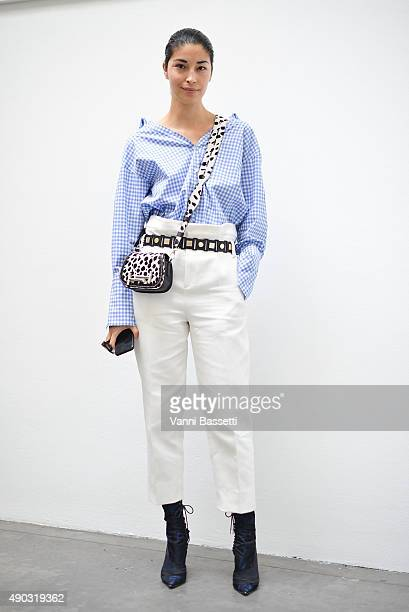 Caroline Issa poses after the Marni show during the Milan Fashion Week Spring/Summer 2016 on September 27 2015 in Milan Italy