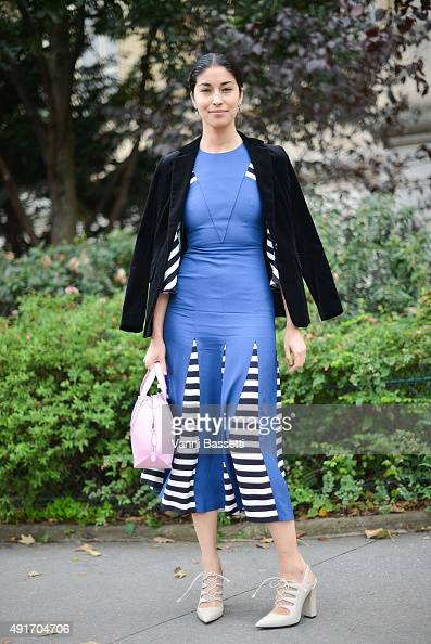 Caroline Issa poses after the Moncler Gamme Rouge show at the Grand Palais during Paris Fashion Week SS16 on October 7 2015 in Paris France