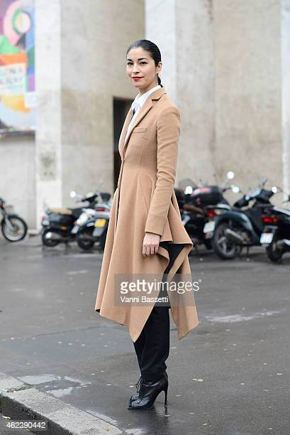 Caroline Issa poses wearing a Dior coat during day two of Paris Haute Couture Spring Summer 2015 on January 26 2015 in Paris France