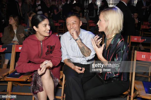 Caroline Issa Shawn Yue and Poppy Delevingne attend the Tommy Hilfiger TOMMYNOW Fall 2017 Show during London Fashion Week September 2017 at The...