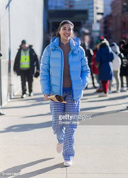 Caroline Issa wearing a blue feather down jacket seen outside J Crew during New York Fashion Week Women's Fall/Winter 2016 on February 14 2016 in New...