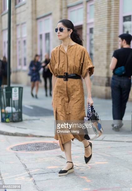 Caroline Issa wearing a brown dress with belt seen in the streets of Manhattan outside Jason Wu during New York Fashion Week on September 8 2017 in...
