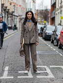 Caroline Issa wearing a suit and wool jacket seen outside Sibling during London Fashion Week Autumn/Winter 2016/17 on February 20 2016 in London...