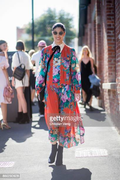 Caroline Issa wearing an orange dress with floral print is seen outside Gucci during Milan Fashion Week Spring/Summer 2018 on September 20 2017 in...