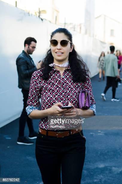 Caroline Issa wearing black denim jeans brown belt red blouse is seen outside Bottega Veneta during Milan Fashion Week Spring/Summer 2018 on...