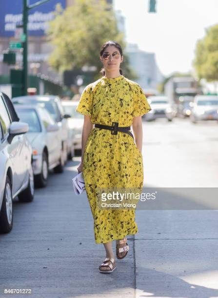 Caroline Issa wearing yellow dress seen in the streets of Manhattan outside Delpozo during New York Fashion Week on September 13 2017 in New York City