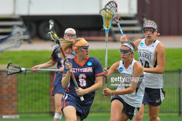 Caroline Jaeger of Gettysburg College is defended by Erin Harvey of College of New Jersey during the Division III Women's Lacrosse Championship held...