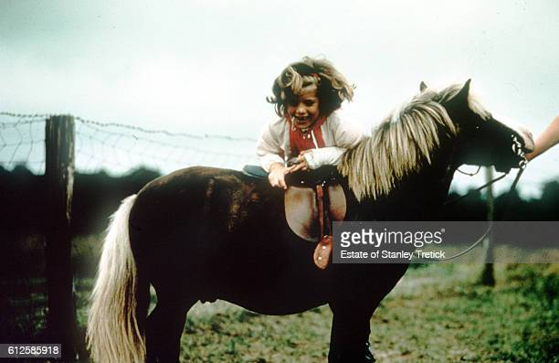 Caroline Kennedy daughter of the 35th President of the United States John F Kennedy and First Lady Jacqueline Lee 'Jackie' Bouvier mounting pony