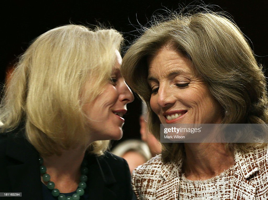 Caroline Kennedy (R) gets a hug from Sen. Kirsten Gillibrand (D-NY) during her Senate Foreign Relations Committee confirmation hearing on Capitol Hill, September 19, 2013 in Washington, DC. If confirmed by the U.S. Senate Kennedy will become the first female U.S. Ambassador to Japan.