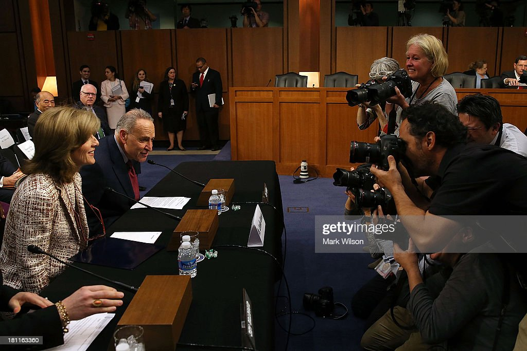 Caroline Kennedy (L) is accompanied by Sen. Chuck Schumer (D-NY) (2nd-L) at her Senate Foreign Relations Committee confirmation hearing on Capitol Hill, September 19, 2013 in Washington, DC. If confirmed by the U.S. Senate Kennedy will become the first female U.S. Ambassador to Japan.
