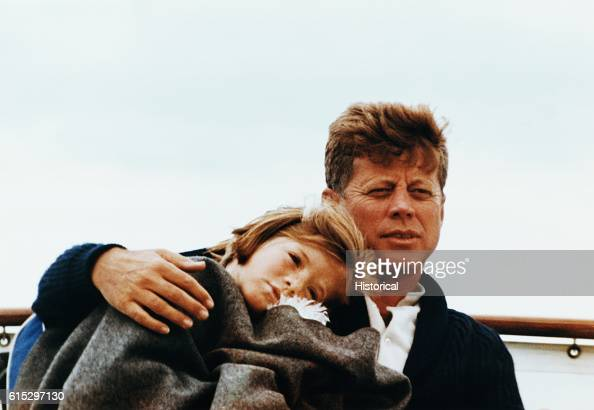Caroline Kennedy leans on the shoulder of her father President John F Kennedy on their yacht the Marlin The Kennedy family often relaxed by sailing...