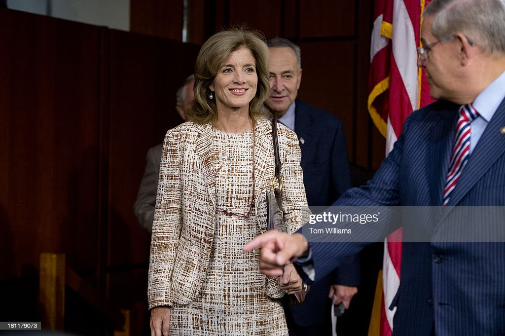 Caroline Kennedy, nominee for ambassador to Japan, arrives with Sen. Chuck Schumer, D-N.Y., background, and Chairman Bob Menendez, D-N.J., for her confirmation hearing before the Senate Foreign Relations Committee hearing in Hart Building.