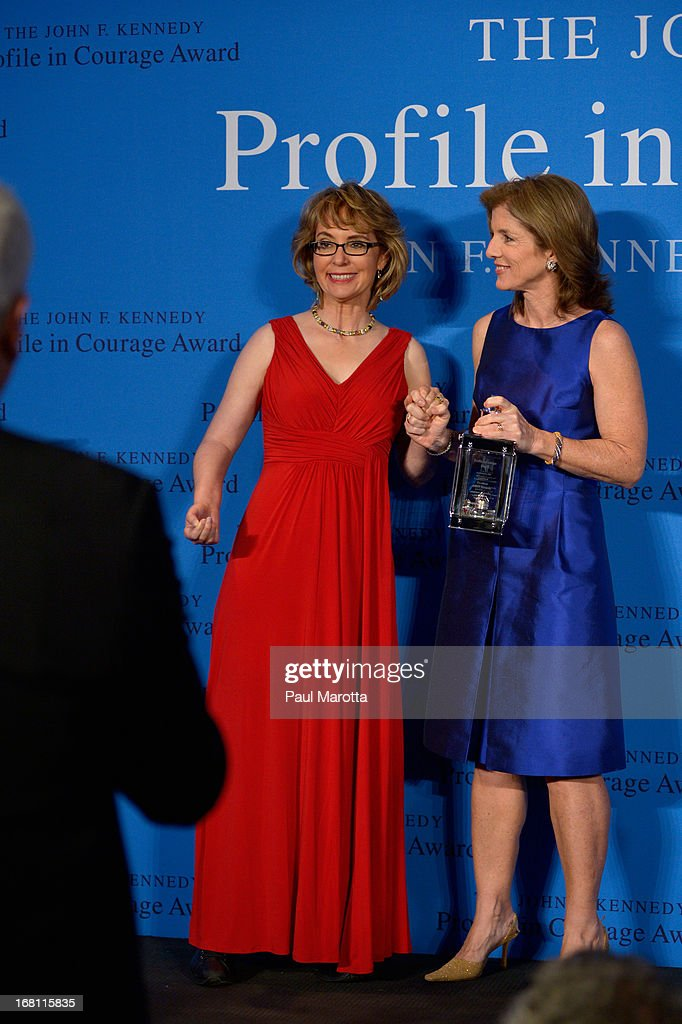 <a gi-track='captionPersonalityLinkClicked' href=/galleries/search?phrase=Caroline+Kennedy&family=editorial&specificpeople=93208 ng-click='$event.stopPropagation()'>Caroline Kennedy</a> presents former Congresswoman Gabrielle 'Gabby' Giffords (L) with the 2013 John F. Kennedy Profile in Courage Award at The John F. Kennedy Presidential Library And Museum on May 5, 2013 in Boston, Massachusetts.