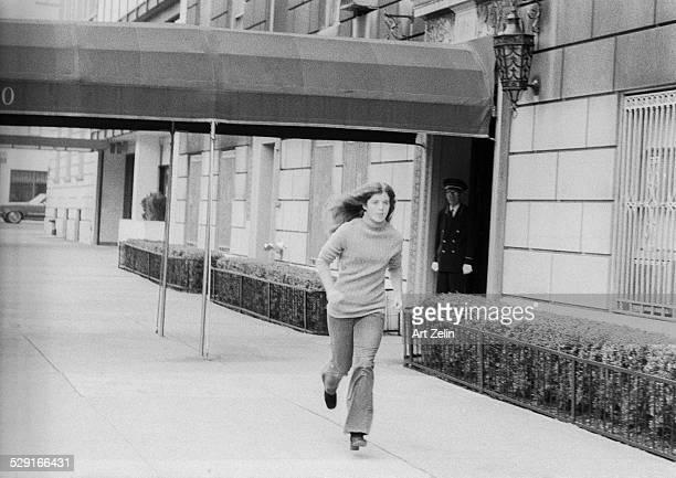 Caroline Kennedy running down the sidewalk outside the kenedy apartment building on 5th ave circa 1970 New York