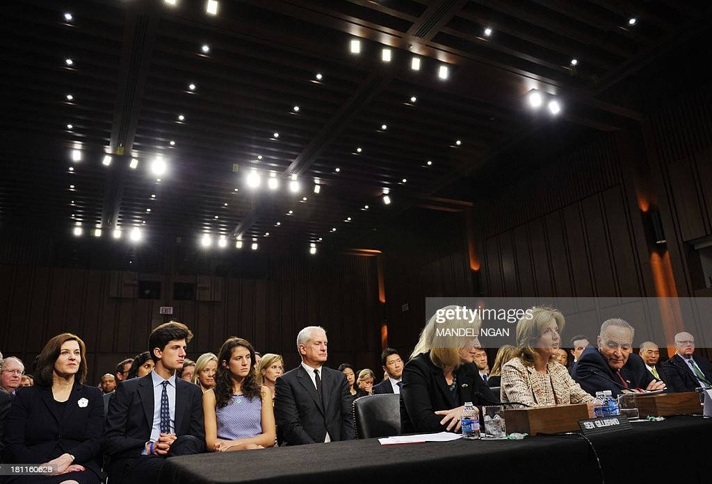 Caroline Kennedy(C-at table) testifies before the Senate Foreign Relations Committee on her nomination to be ambassador to Japan in the Hart Senate Office Building on Capitol Hill in Washington, DC on September 19, 2013. If confirmed by the Senate, Kennedy, 55, the daughter of slain President John F. Kennedy, would be at the center of a U.S. relationship with one of the world's largest economies and a key ally in the Asian-Pacific region. Flanking Kennedy are Senator Kirsten Gillibrand (L), D-NY, and Senator Chuck Schumer, D-NY, who introduced Kennedy earlier. AFP PHOTO/Mandel NGAN