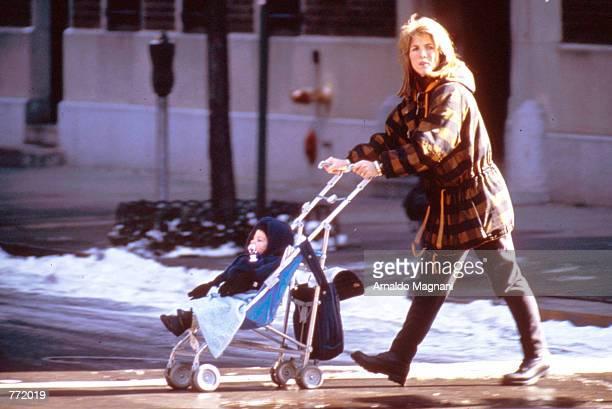 Caroline Kennedy with baby John on stroller in New York City February 27 1994