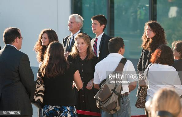 Caroline Kennedy with her children Rose and John and Tatiana and her husband Edwin Schlossberg greet people waiting in line to pass by the casket...
