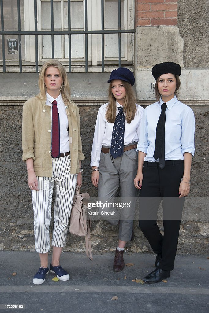 Caroline Koning, Kate Villevoye and Wara Juana Gutierret-Mamani wearing Jupe by Jackie hats and ties on day 5 of Paris Collections: Men on June 30, 2013 in Paris, France.