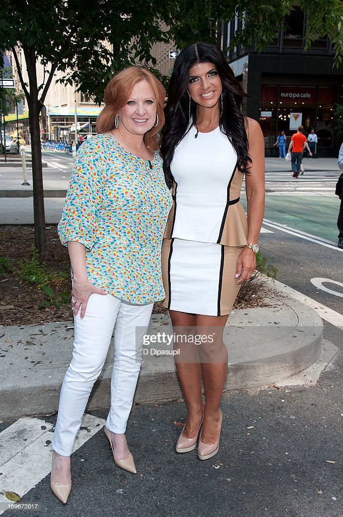 Caroline Manzo (L) and Teresa Giudice of 'Real Housewives of New Jersey' visit 'Extra' in Times Square on May 30, 2013 in New York City.