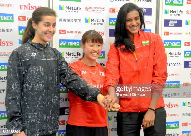 Caroline Marin of Spain Nozomi Okuhara of Japan and Pusarla Venkata Sindhu of India shake hands during a press confernce ahead of the Daihatsu Yonex...
