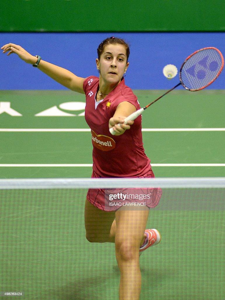 Caroline Marin of Spain returns a shot Japan s Nozomi Okuhara