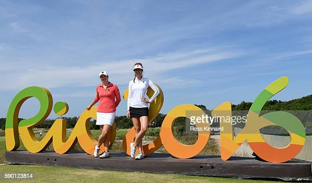Caroline Masson and Sandra Gal of Germany pose by the Rio 2016 sign prior to the Women's Individual Stroke Play golf at the Olympic Golf Course at...
