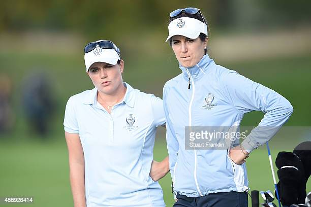 Caroline Masson and Sandra Gal of the European Team look on during the afternoon fourball matches on day one of the Solheim Cup 2015 at St LeonRot...