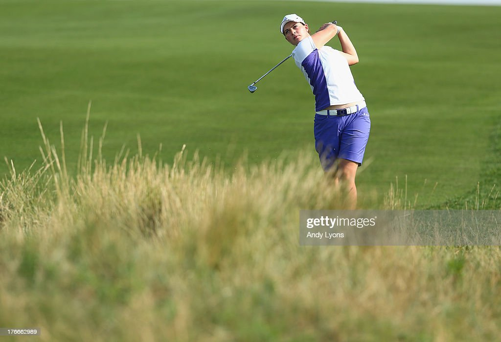 <a gi-track='captionPersonalityLinkClicked' href=/galleries/search?phrase=Caroline+Masson&family=editorial&specificpeople=2259560 ng-click='$event.stopPropagation()'>Caroline Masson</a> of Germany and the European Solheim Cup Team hits her second shot on the 15th hole during the afternoon fourball matches at 2013 Solheim Cup at the Colorada Golf Club on August 16, 2013 in Parker, Colorado.