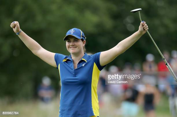 Caroline Masson of Germany and the European Team holes a long birdie putt to win the 10th hole in her match against Michelle Wie of the United States...