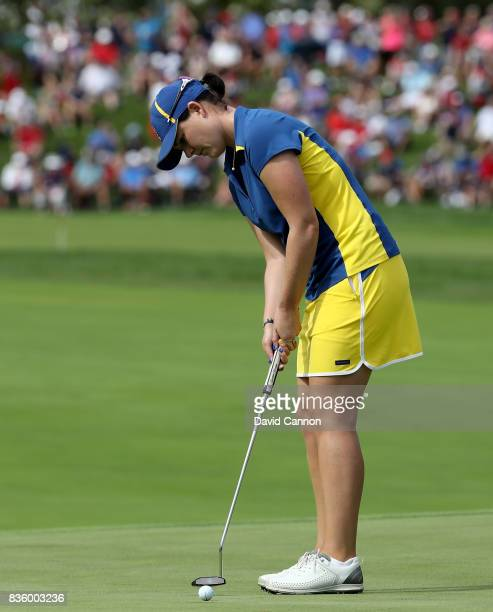 Caroline Masson of Germany and the European team in action against Michelle Wie of the United States team during the final day singles matches in the...