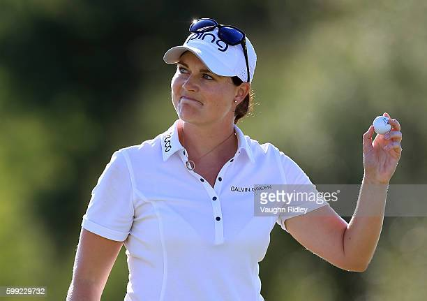 Caroline Masson of Germany celebrates after sinking her final putt on the 18th green during the final round of the Manulife LPGA Classic at Whistle...