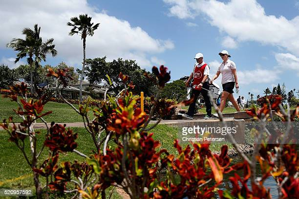 Caroline Masson of Germany crosses the 18th hole bridge during the first round of the LPGA LOTTE Championship Presented By Hershey at Ko Olina Golf...