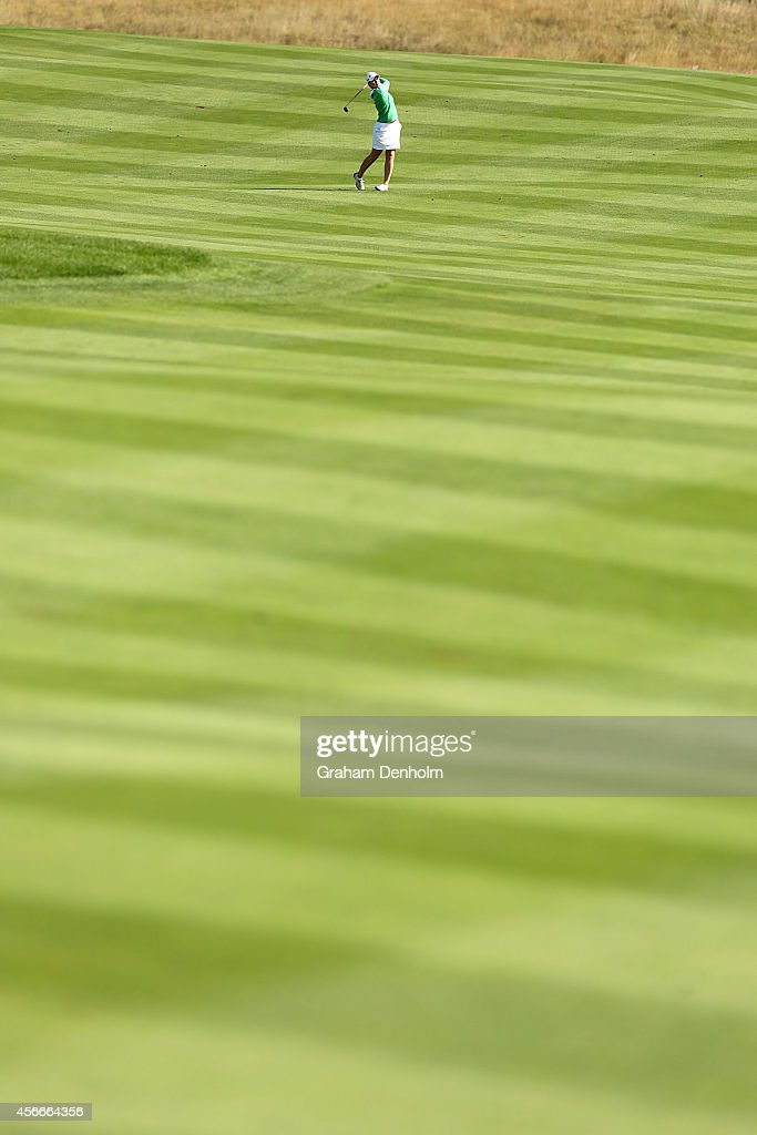 <a gi-track='captionPersonalityLinkClicked' href=/galleries/search?phrase=Caroline+Masson&family=editorial&specificpeople=2259560 ng-click='$event.stopPropagation()'>Caroline Masson</a> of Germany hits a shot from the fairway during day four of the 2014 Reignwood LPGA Classic at Reignwood Pine Valley Golf Club on October 5, 2014 in Beijing, China.