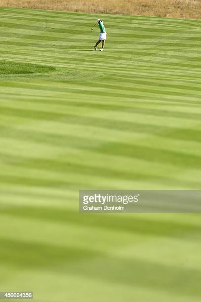 Caroline Masson of Germany hits a shot from the fairway during day four of the 2014 Reignwood LPGA Classic at Reignwood Pine Valley Golf Club on...