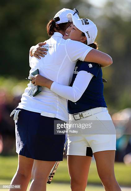 Caroline Masson of Germany hugs Minjee Lee of Australia on the 18th hole following the final round of the Manulife LPGA Classic at Whistle Bear Golf...