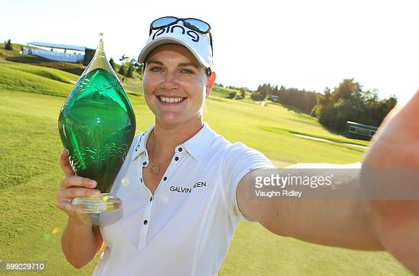 Caroline Masson of Germany imitates a 'selfie' as she poses with the Championship Trophy after winning the Manulife LPGA Classic at Whistle Bear Golf...