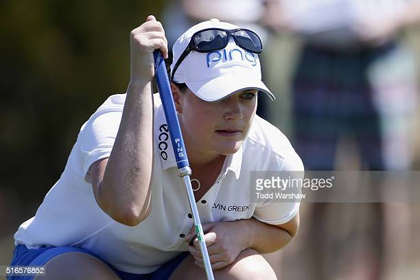 Caroline Masson of Germany lines up a putt on the first green during the third round of the LPGA JTBC Founders Cup at Wildfire Golf Club on March 19...