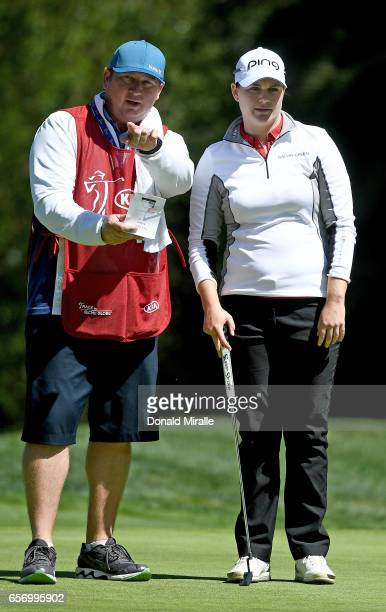 Caroline Masson of Germany lines up a putt with her caddie during the First Round of the KIA Classic at the Park Hyatt Aviara Resort on March 23 2017...