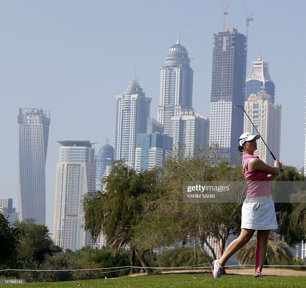 Caroline Masson of Germany plays a shot during the final round of the 2012 Dubai Ladies Masters Golf on December 8, 2012 in the Gulf emirate of Dubai. AFP PHOTO / KARIM SAHIB